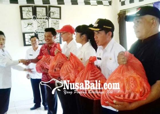 Nusabali.com - dinas-pppa-bagikan-1000-sembako