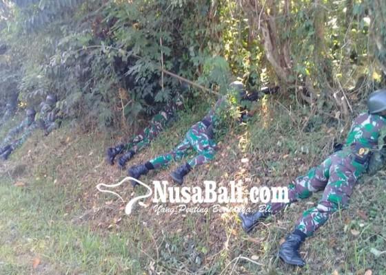 Nusabali.com - tni-sparatis-baku-tembak-di-hutan-melaya