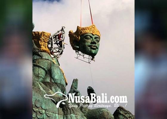 Nusabali.com - angin-kencang-pemasangan-kepala-dewa-wisnu-diundur