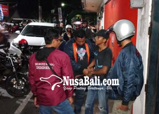 Nusabali.com - polisi-amankan-pelaku-pungli-parkir
