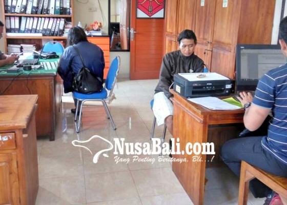 Nusabali.com - oknum-ptt-dipolisikan-istri