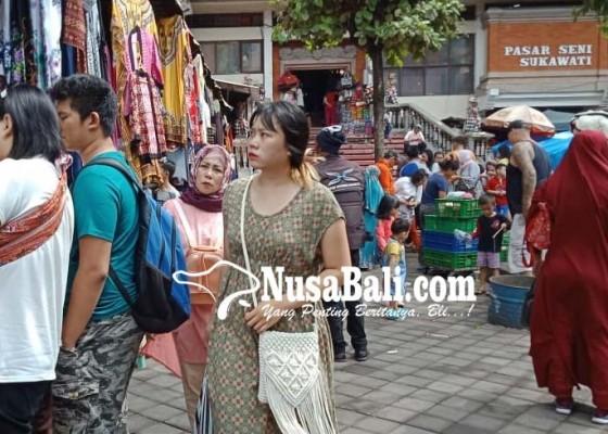 Nusabali.com - wisdom-serbu-pasar-seni-sukawati