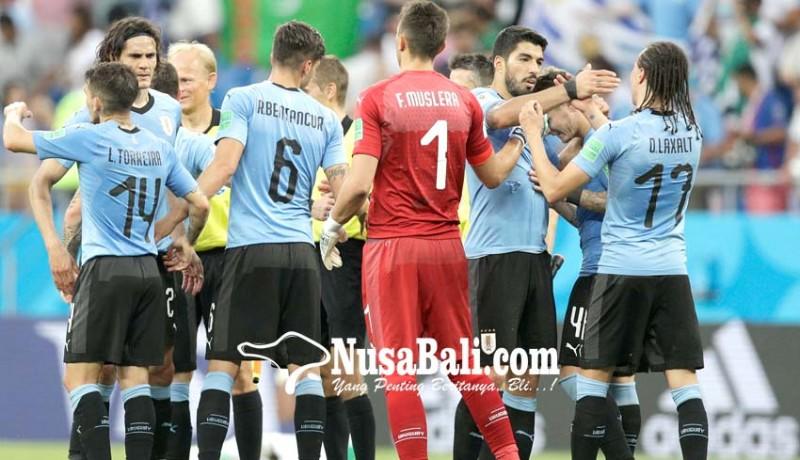 www.nusabali.com-uruguay-rusia-ke-16-besar