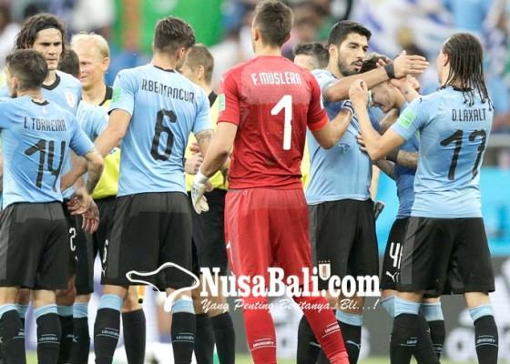 Nusabali.com - uruguay-rusia-ke-16-besar