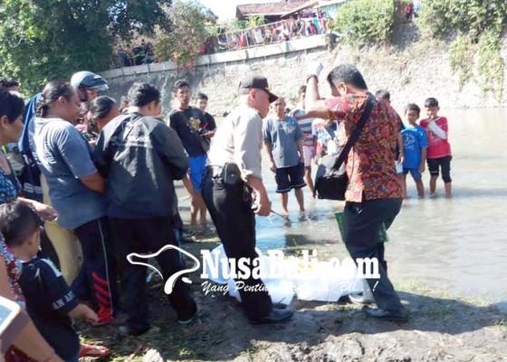 Nusabali.com - orok-terendam-lumpur-gegerkan-warga