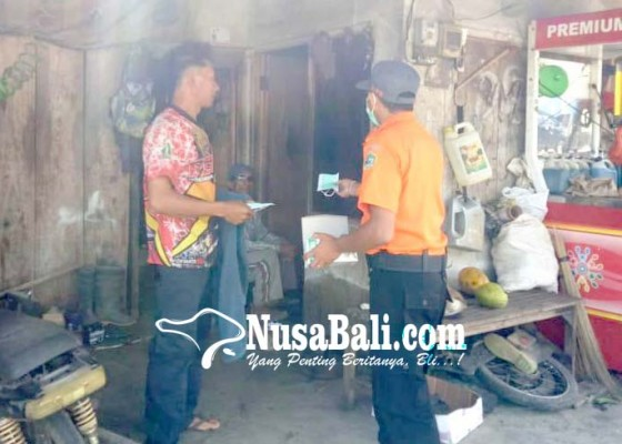 Nusabali.com - bpbd-bagikan-masker-di-kecamatan-pupuan