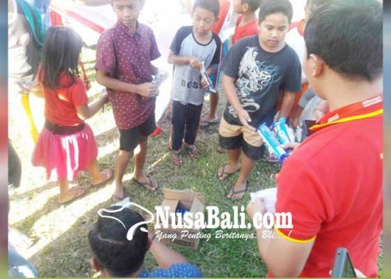 Nusabali.com - alfamart-salurkan-bantuan-ke-pengungsi