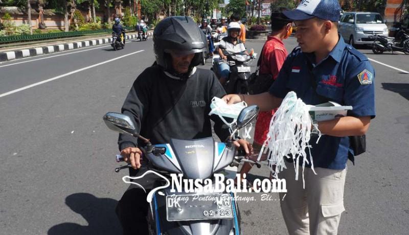 www.nusabali.com-gianyar-terpapar-abu-petugas-bagikan-masker