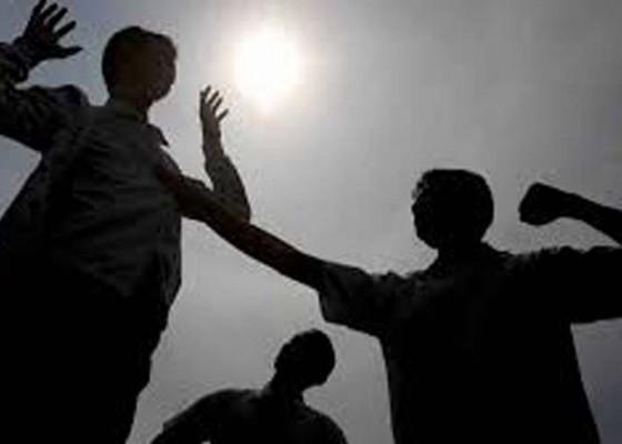 Nusabali.com - dijerat-pasal-berlapis-terancam-7-tahun-penjara