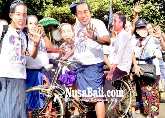Nusabali.com - daftar-caleg-kader-nasdem-naik-sepeda-bonceng-jokowi