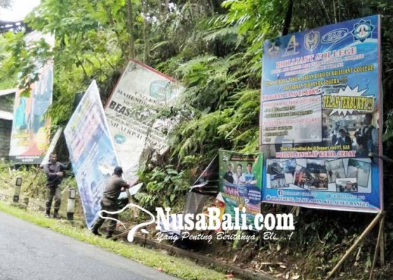Nusabali.com - baliho-rusak-masih-terpasang-jalur-bangli-kayuambua-kumuh