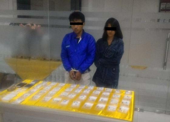 Nusabali.com - impor-12-kg-shabu-pasangan-kekasih-ditangkap
