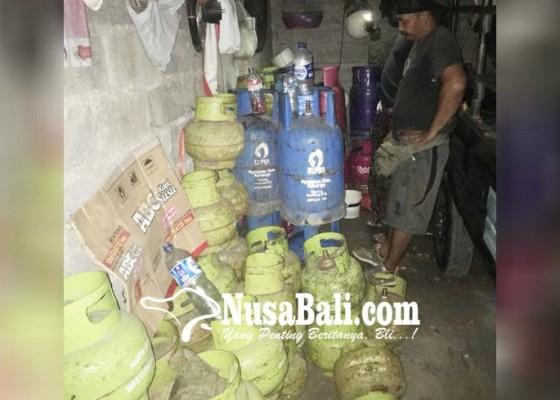 Nusabali.com - garasi-tempat-oplos-gas-digerebek