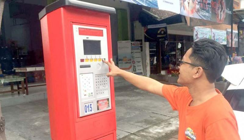 www.nusabali.com-baru-sebulan-launching-satu-mesin-e-parkir-mati