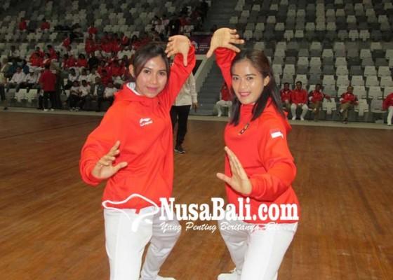 Nusabali.com - pesilat-dwi-yantisang-ayu-sidan-selalu-sabet-emas-ganda-putri