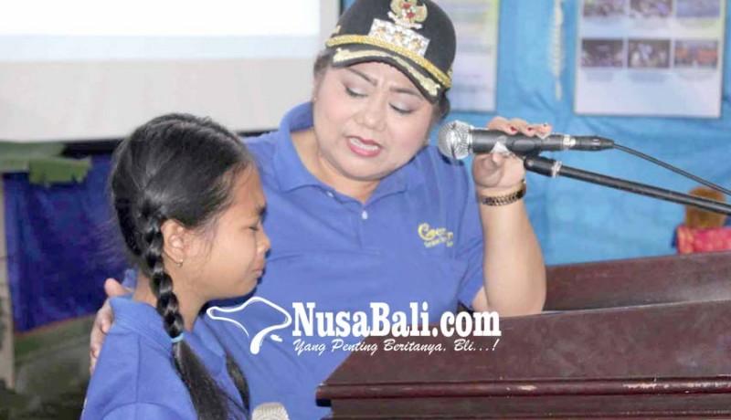www.nusabali.com-bupati-ajak-siswa-sd-gemar-makan-ikan