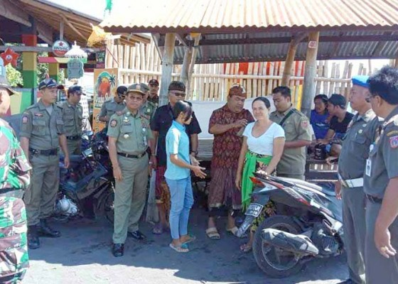 Nusabali.com - tiga-pemilik-warung-makan-dapat-sp-i