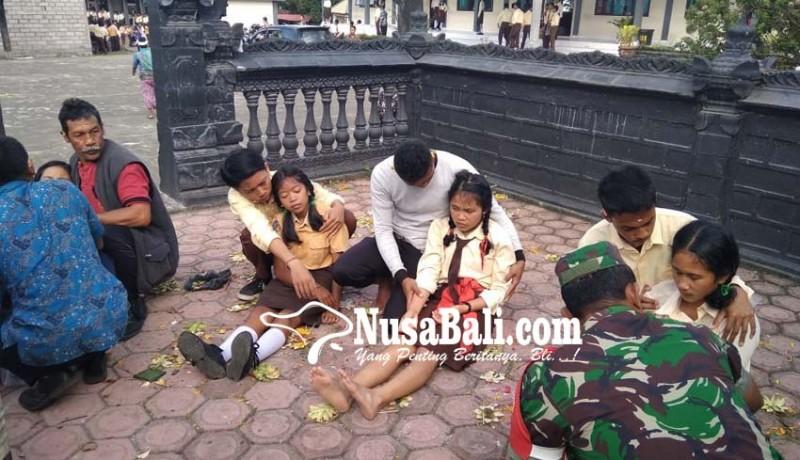 www.nusabali.com-kerauhan-15-siswi-kemarin-diawali-teriakan-pegawai-tu