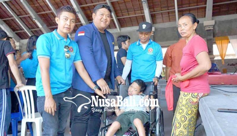 www.nusabali.com-karang-taruna-provinsi-salurkan-kursi-roda
