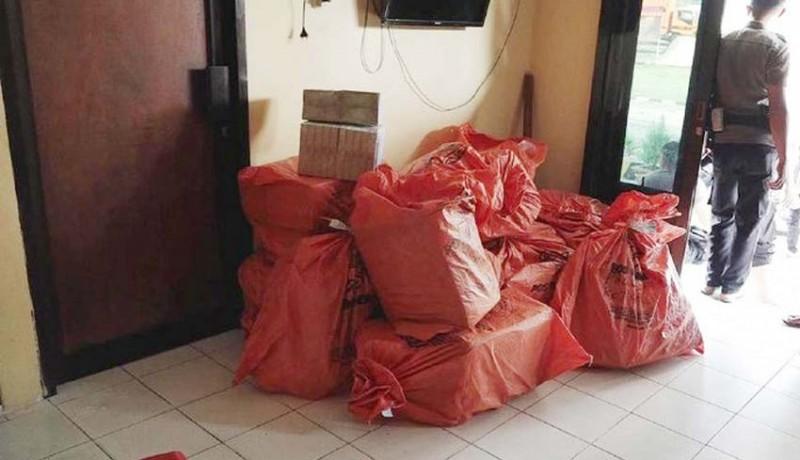 www.nusabali.com-paket-misterius-berisi-uang-pengirim-mengaku-dari-palu