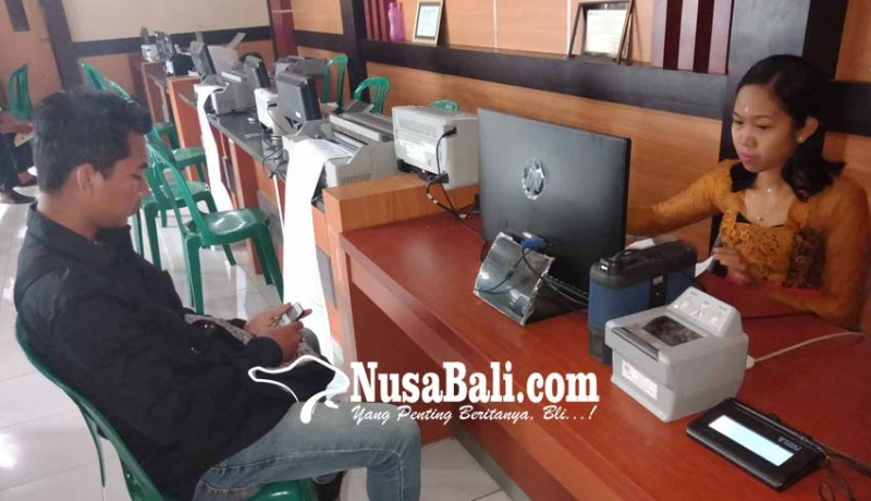 www.nusabali.com-cetak-e-ktp-macet