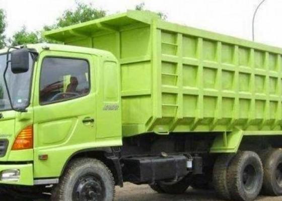Nusabali.com - truk-pengangkut-material-kena-jam-khusus