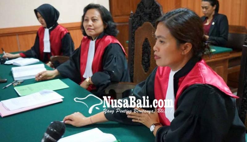 www.nusabali.com-pakaian-bali-tertutup-toga