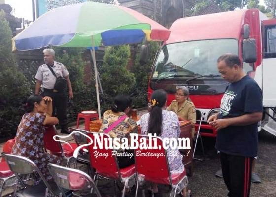 Nusabali.com - rekaman-e-ktp-disdukcapil-sasar-pasar