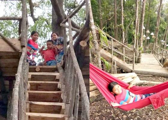 Nusabali.com - pengunjung-berdatangan-ke-objek-jelajah-hutan