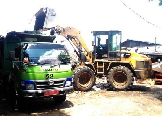 Nusabali.com - pasca-antrean-truk-sampah-tpss-dan-bank-sampah-menumpuk