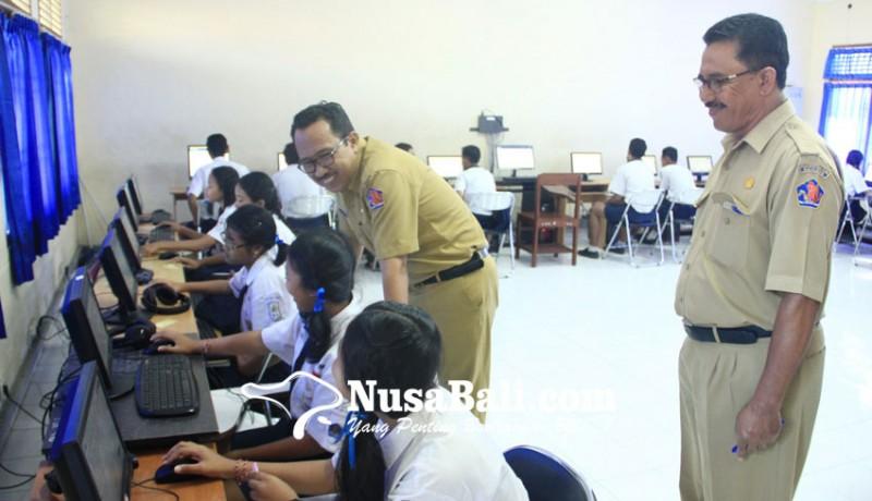 www.nusabali.com-susah-sinyal-sumbangan-komputer-dibatalkan