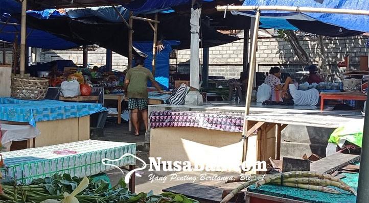 www.nusabali.com-pedagang-pasar-bona-bertahan-meski-sepi