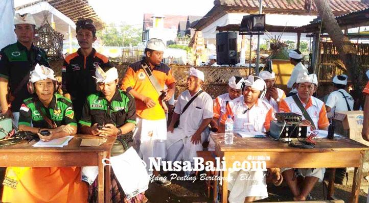 www.nusabali.com-anggota-rapi-ngayah-di-pantai-biaslantang