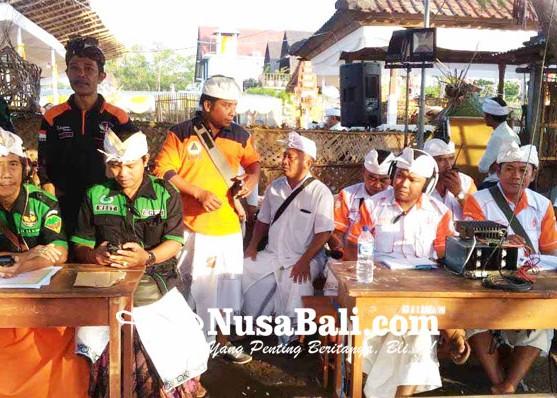 Nusabali.com - anggota-rapi-ngayah-di-pantai-biaslantang