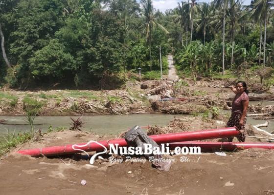 Nusabali.com - baru-rampung-jembatan-gantung-putus