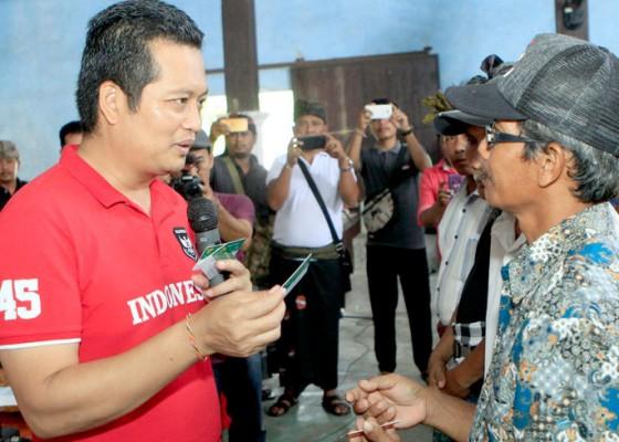 Nusabali.com - kembang-imbau-aparat-desa-mendata-warga-yang-belum-kebagian-jkn-kis