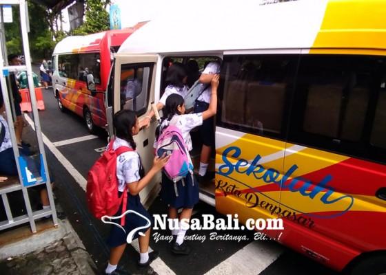 Nusabali.com - penerapan-tiket-sampah-naik-bus-sekolah-diundur