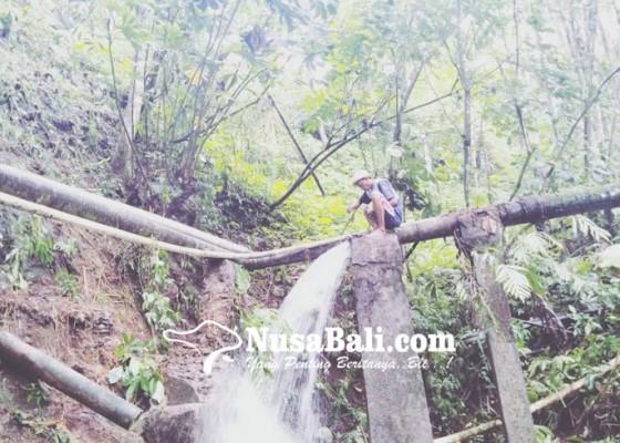 Nusabali.com - pipa-induk-pdam-putus-diterjang-air