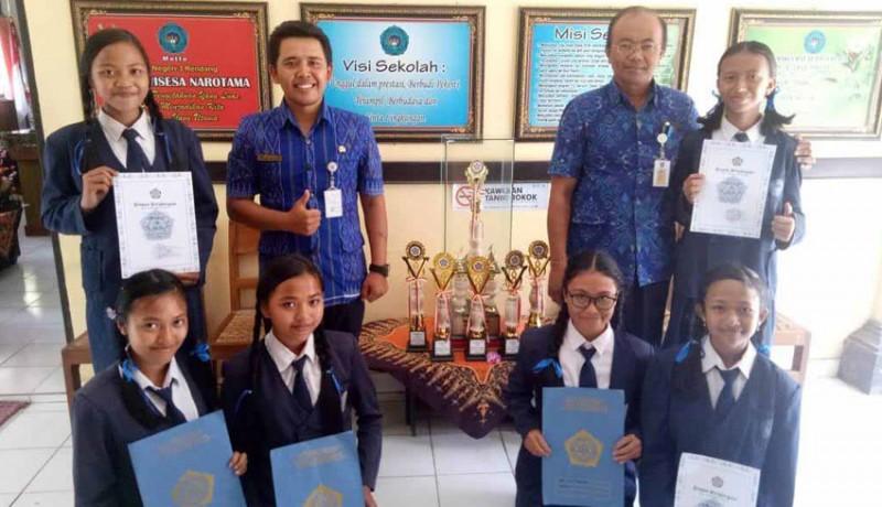 www.nusabali.com-awal-tahun-smpn-3-rendang-sabet-7-gelar-juara