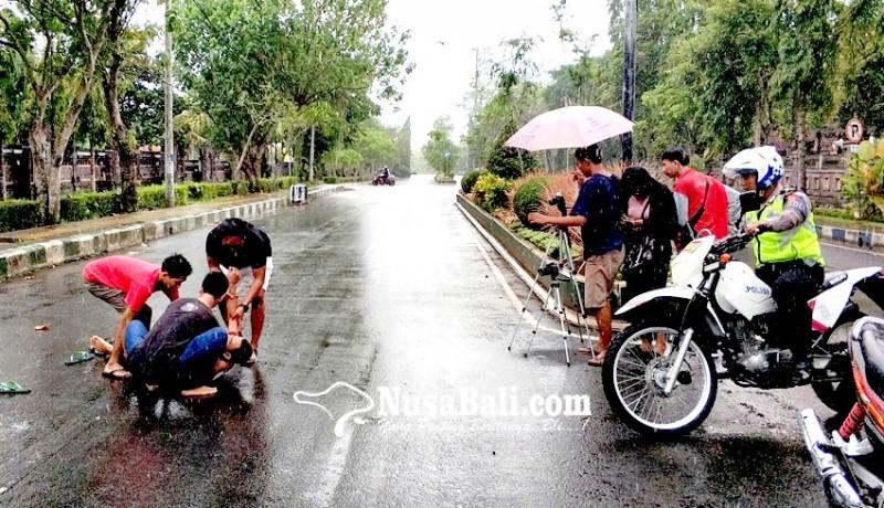www.nusabali.com-libatkan-anggota-polantas-dan-diajak-hujan-hujanan