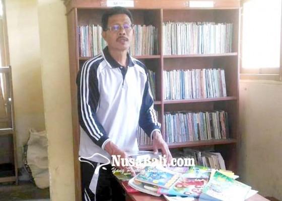 Nusabali.com - sdn-2-pengiyangan-manfaatkan-bekas-mes-untuk-perpustakaan