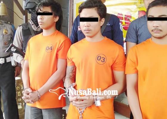 Nusabali.com - main-keroyok-anggota-ormas-dijuk