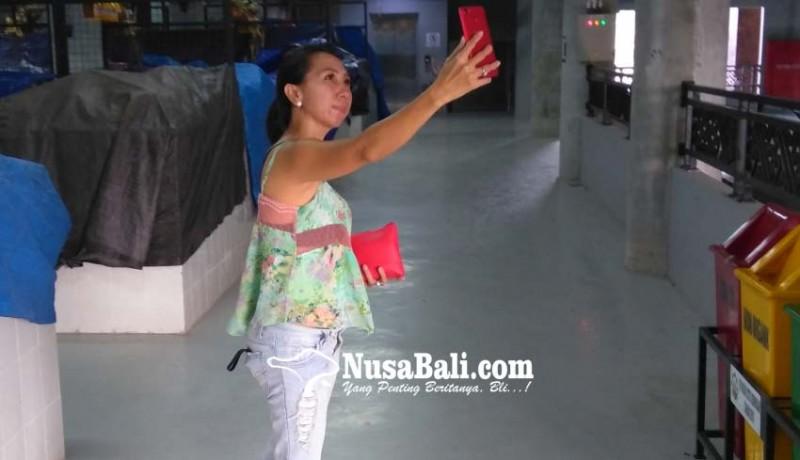 www.nusabali.com-pedagang-kurang-tertarik-wifi