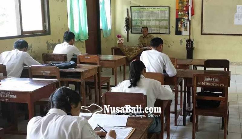 www.nusabali.com-16-sekolah-diliburkan-usbn-sman-bebandem-diundur