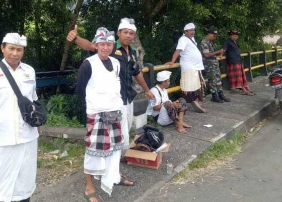 Nusabali.com - sebanyak-40-pecalang-dari-22-banjar-adat-berjaga-jaga