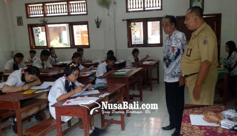 www.nusabali.com-hari-pertama-usbn-smp-empat-siswa-tidak-hadir