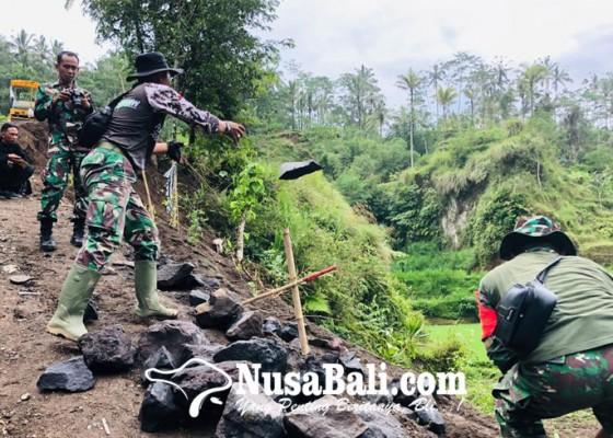 Nusabali.com - tmmd-ke-104-tuntaskan-kutukan-niskala-masyarakat-peninjoan