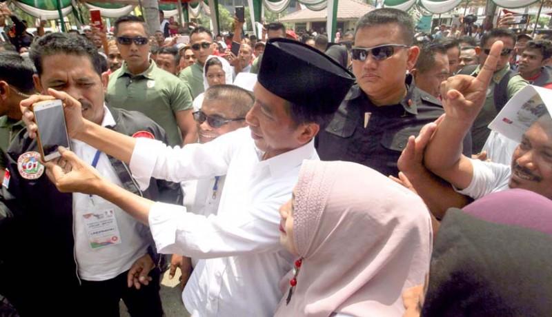 www.nusabali.com-jokowi-kampanye-terbuka-tugas-tugasnya-dialihkan-ke-jk