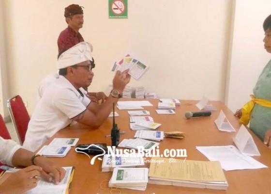 Nusabali.com - berpakaian-adat-pasien-rsj-ikut-nyoblos