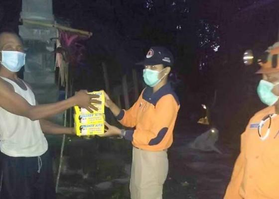 Nusabali.com - bpbd-karangasem-bagikan-masker